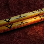Tom Sharpe Concert played drumsticks